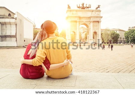 Romantic couple enjoying the sunset watching the monuments in the city center - stock photo