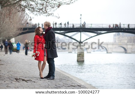 Romantic couple in love dating near Pont des Arts in Paris - stock photo