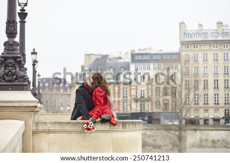 Romantic couple in love having a date in Paris - stock photo