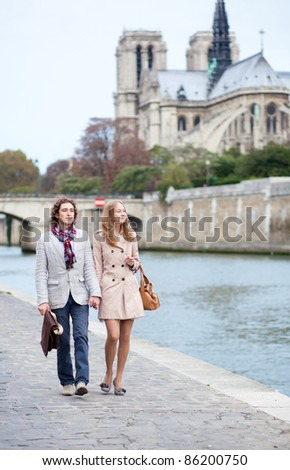 Romantic couple in Paris at the embankment - stock photo