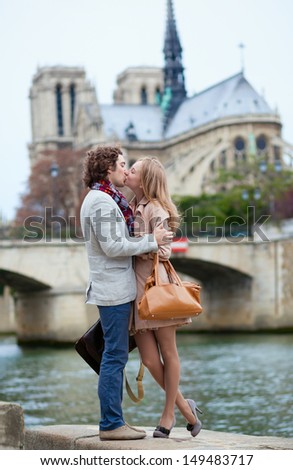 Romantic couple in Paris kissing - stock photo