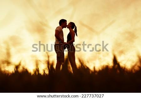 Romantic couple kissing - stock photo