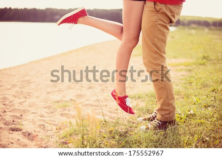 romantic couple kissing on a hot summer beach - stock photo