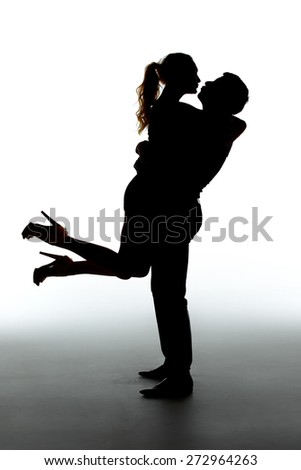 Romantic couple kissing - silhouettes on white background - stock photo