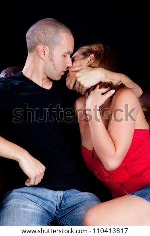 Romantic couple making out on the couch, - stock photo
