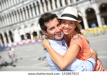 Romantic couple on Piazza San Marco in Venice - stock photo