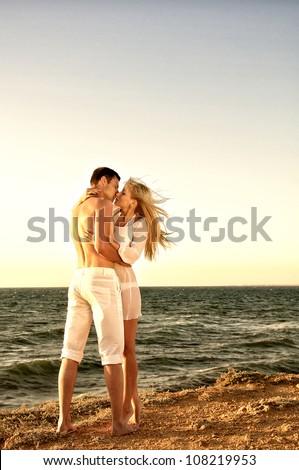 Romantic couple on the beach - stock photo
