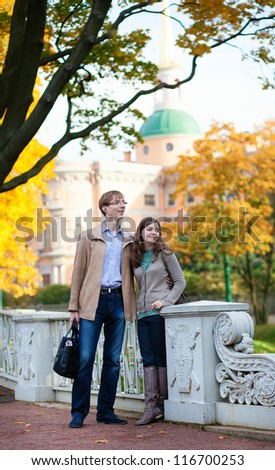 Romantic couple outdoors by fall - stock photo