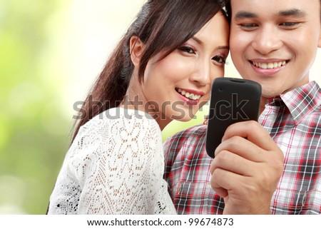 romantic couple reading phone message - stock photo