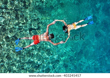 Romantic couple snorkeling in Phuket, Thailand. Above view - stock photo
