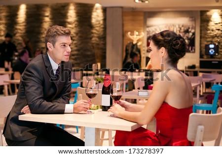 Romantic couple talking in restaurant - stock photo