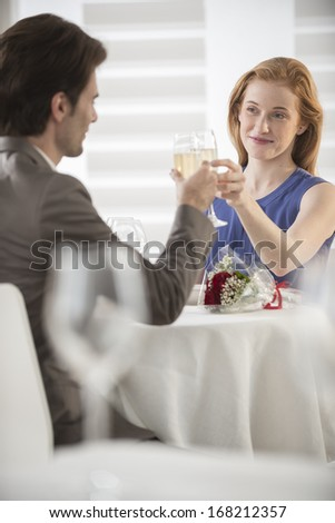 romantic couple toast with champagne at restaurant - stock photo