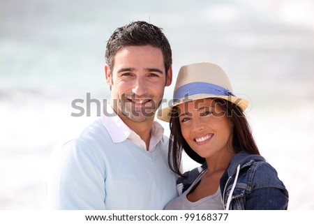 Romantic couple walking by the beach - stock photo