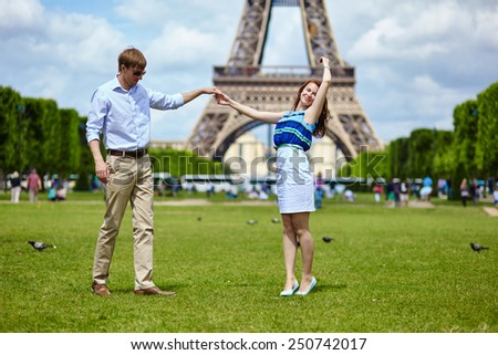 Romantic dating couple dancing in Paris near the Eiffel tower - stock photo