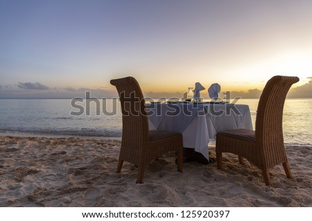 romantic dinner on beach with copy space for your text - stock photo