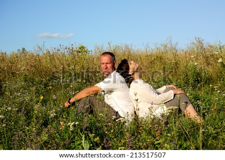 Romantic family on a meadow  - stock photo