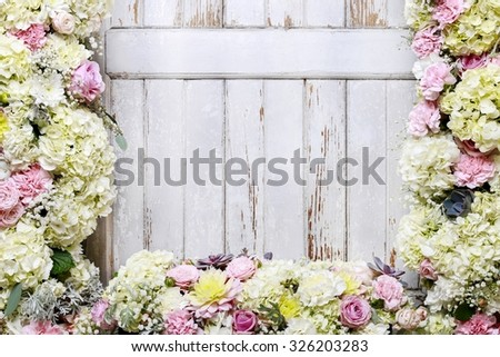 Romantic flower ornament with rose, dahlia, hortensia and carnation flowers. Wooden background, copy space. - stock photo