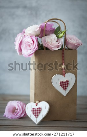 Romantic Gift with pink roses and handmade hearts - vintage style - stock photo