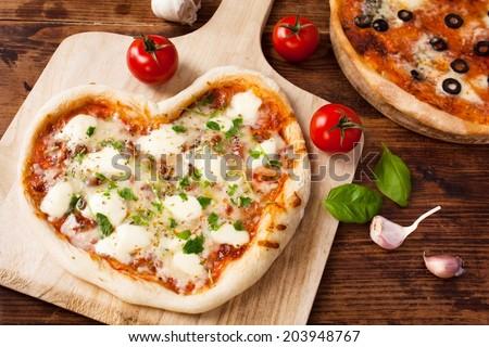 Romantic Heart Shaped Italian Pizza Margherita - stock photo