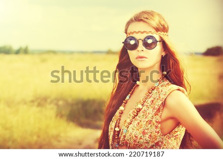 Romantic hippie girl standing in a field. Summer. Hippie style.  - stock photo