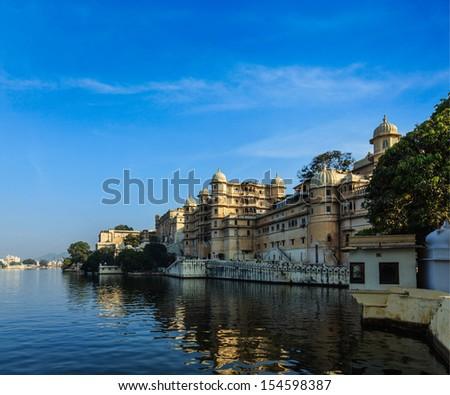Romantic India luxury tourism concept background - Udaipur City Palace and Lake Pichola. Udaipur, Rajasthan, India - stock photo