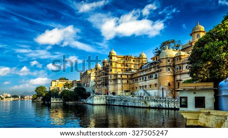 Romantic India luxury tourism wallpaper  - Panorama of Udaipur City Palace and Lake Pichola. Udaipur, Rajasthan, India - stock photo