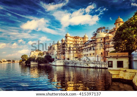 Romantic India luxury tourism wallpaper  - Vintage retro effect filtered hipster style image of Udaipur City Palace and Lake Pichola. Udaipur, Rajasthan, India - stock photo