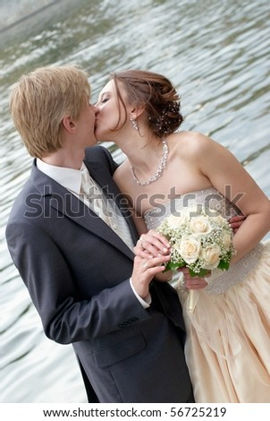 Romantic kiss of the bride and the groom - stock photo