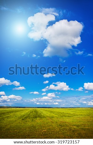 Romantic landscape with a field on a clear sunny day. - stock photo