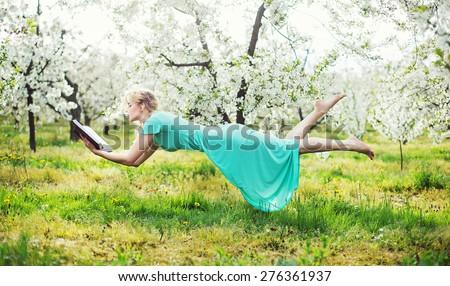 Romantic levitating blonde beauty - stock photo