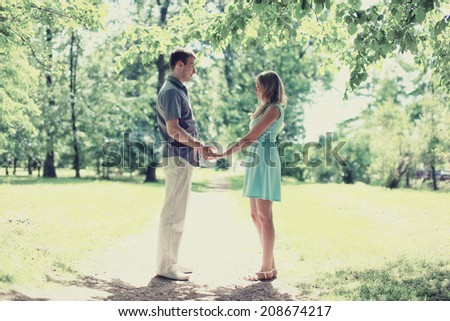 Romantic lovely happy couple in love, date, romance, wedding - concept, sunny light day, vintage colors - stock photo