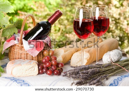 Romantic lunch setting with wine and food for two - stock photo