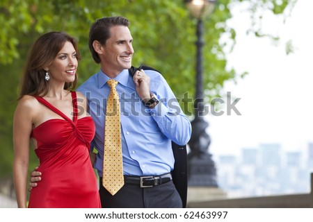 Romantic man and woman couple by the River Thames in London, England, Great Britain, Europe - stock photo