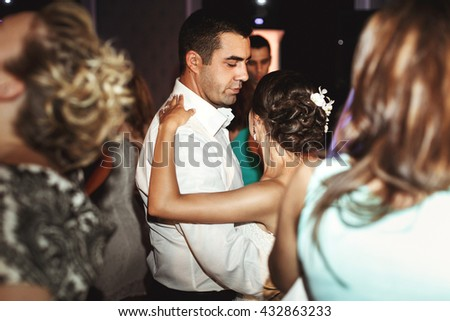 Romantic married couple bride and groom dancing at wedding reception in france - stock photo