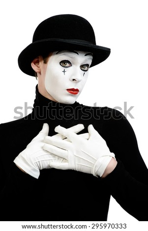Romantic mime artist puts his hands to his heart performing love. Isolated over white. - stock photo