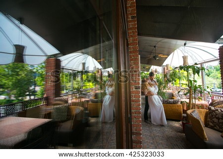 Romantic moment of the couple in love on the terrace - stock photo