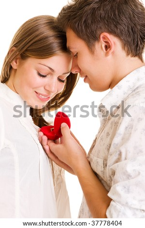 romantic moment. young man giving his beloved ring - stock photo