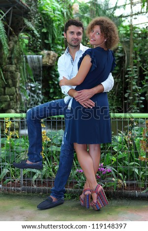Romantic moments between a couple in a tropical garden - stock photo