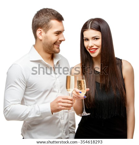 Romantic new year's eve fashion couple toasting with champagne. Isolated on white. - stock photo