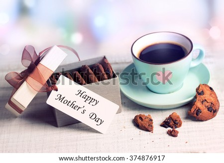 Romantic pastel coffee cup & present box cookies background.Mother's day holiday nobody greeting card poster. - stock photo