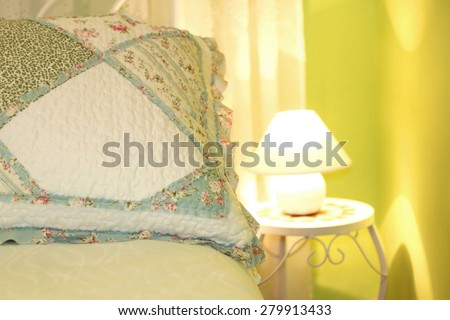 Romantic pillow in a shabby chic bedroom with green walls. Close-up, selective focus.  - stock photo