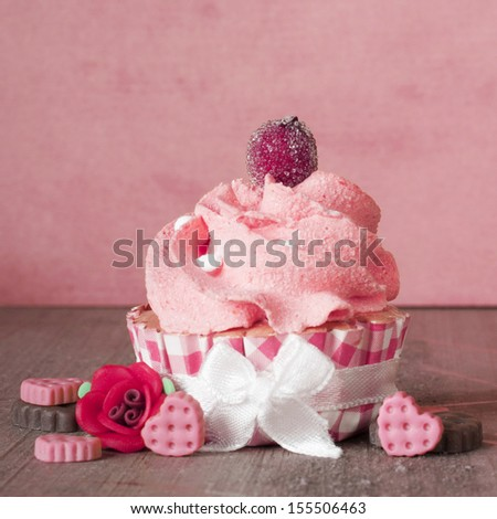Romantic pink cupcake with cookie hearts  - stock photo