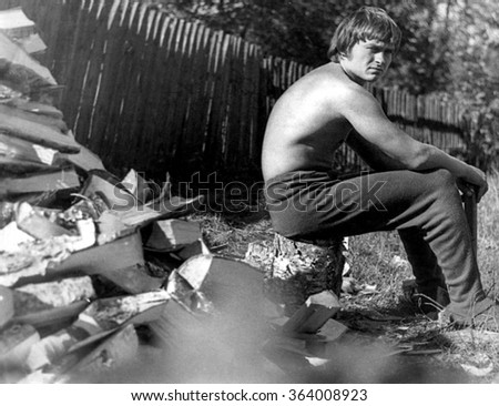 Romantic portrait of a man outdoor in the country. black and white  (Note: Scanned from high grain black and white film.)  - stock photo
