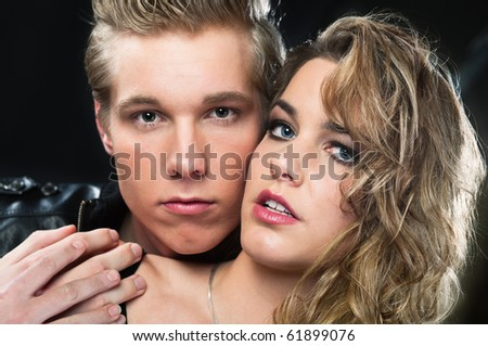 Romantic portrait of young blond handsome man and beautiful woman - stock photo