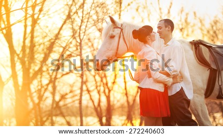 Romantic retro dating. White horse on the background. - stock photo