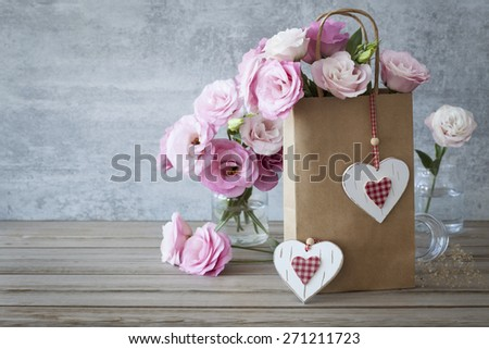 Romantic Retro style Love background with pink roses and handcrafted hearts - stock photo