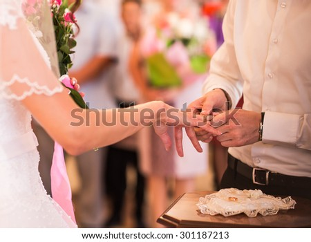 Romantic scene from weeding celebration, wedding rings - stock photo