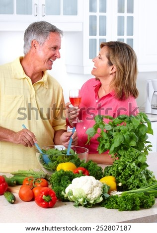 Romantic Senior couple cooking in the kitchen.  - stock photo