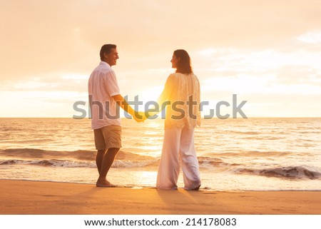 Romantic Senior Couple Enjoying Sunset at the Beach - stock photo