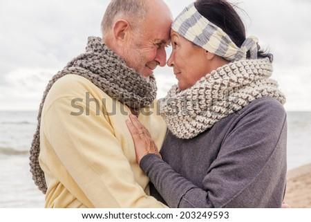 romantic senior couple on the coast - stock photo